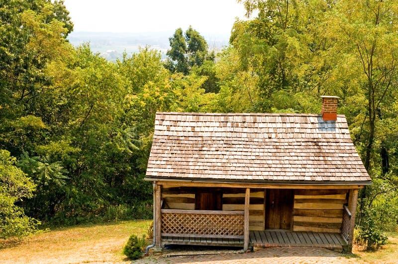 Vieille cabine de logarithme naturel pionnière photos libres de droits
