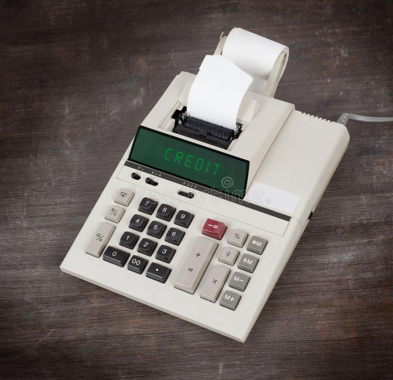 Vieille calculatrice montrant un texte image stock