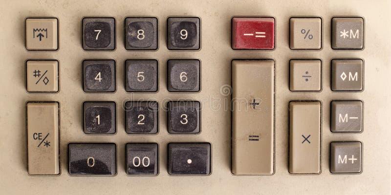 Vieille calculatrice pour effectuer le travail connexe par bureau photo stock