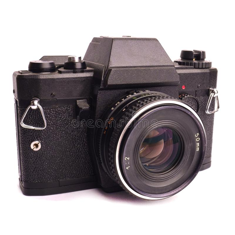 Vieille caméra colorée noire de film de cru avec la lentille d'isolement image stock