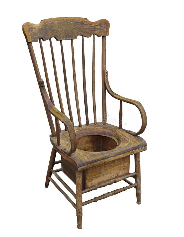 Vieille chaise de pot adulte en bois d 39 isolement photo for Vieille chaise en bois