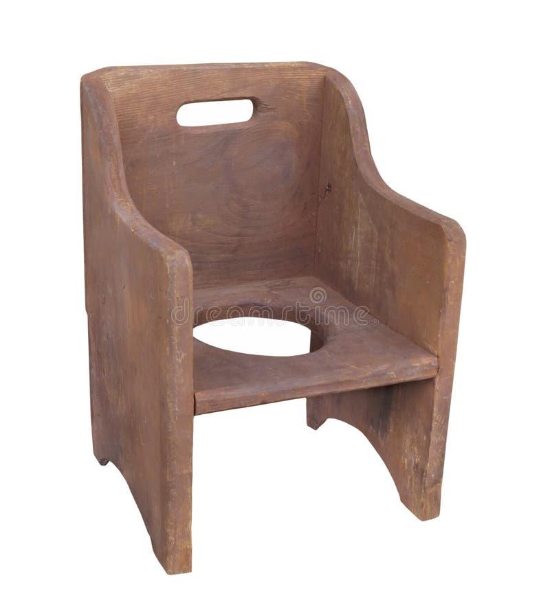Vieille chaise de pot en bois d'enfant d'isolement photo libre de droits