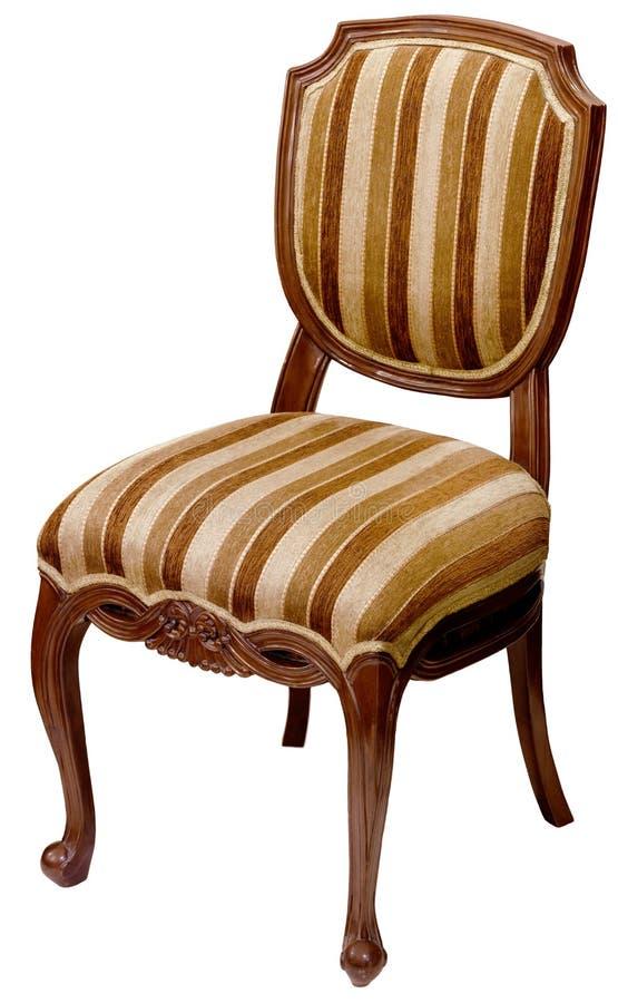 Vieille chaise en bois rayée d'isolement sur le blanc photographie stock libre de droits