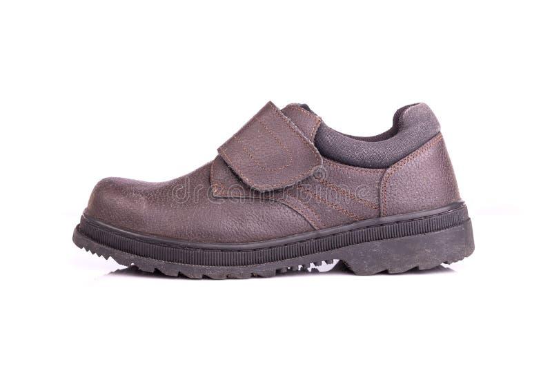 Vieille chaussure de sécurité noire d'isolement sur le fond blanc images stock