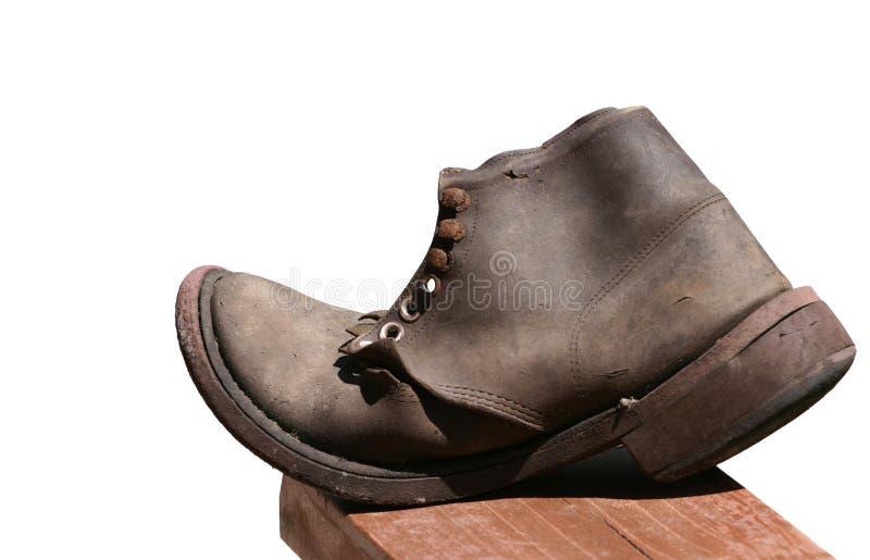 Vieille chaussure en cuir d'isolement image stock
