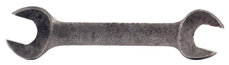 Vieille clé en croissant d'acier inoxydable d'isolement sur le blanc images stock