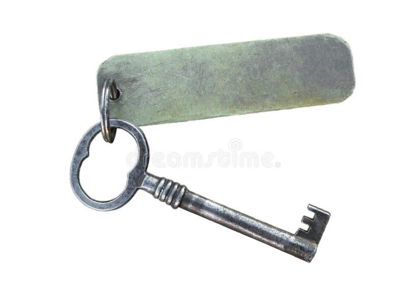 Vieille clé et étiquette image stock