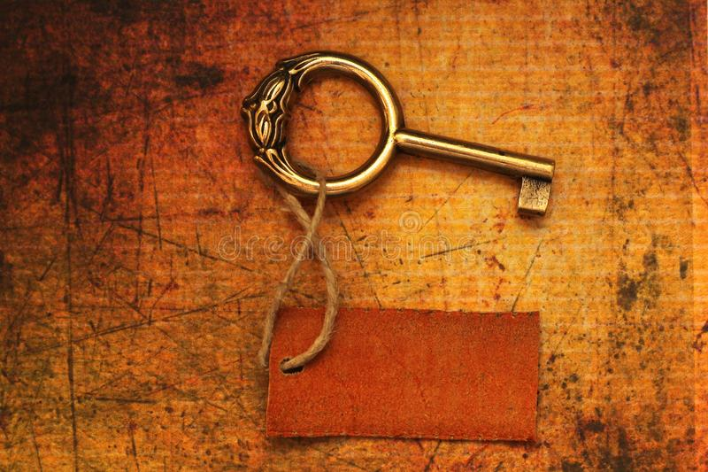 Vieille clé et étiquette photo libre de droits