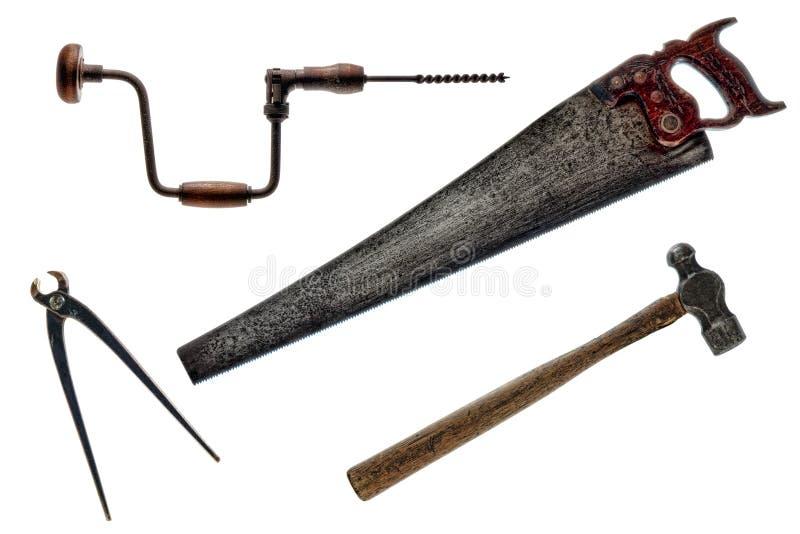 Vieille collection d'outils de cru antique d'isolement   images libres de droits