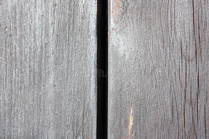 Vieille, en bois texture, avec la fente dans le milieu et les veines du bois lui-même photos libres de droits