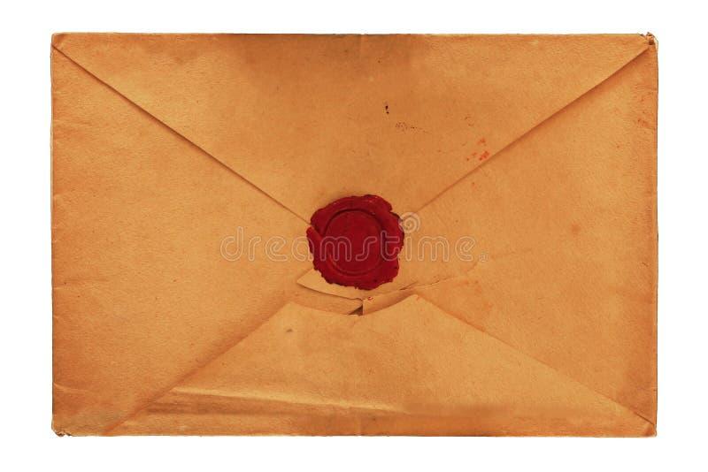 Vieille enveloppe de papier de vintage avec de la cire de cachetage rouge photos libres de droits
