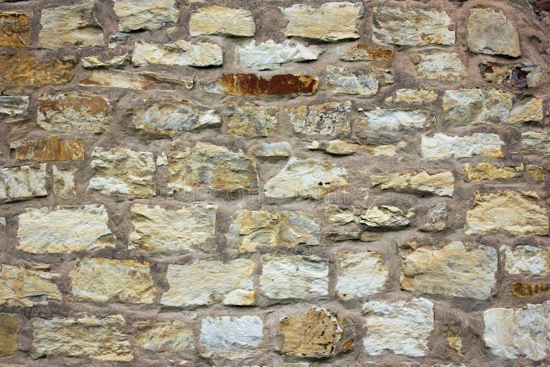 Vieille grande fin beige de texture de fond de mur en pierre  photo libre de droits