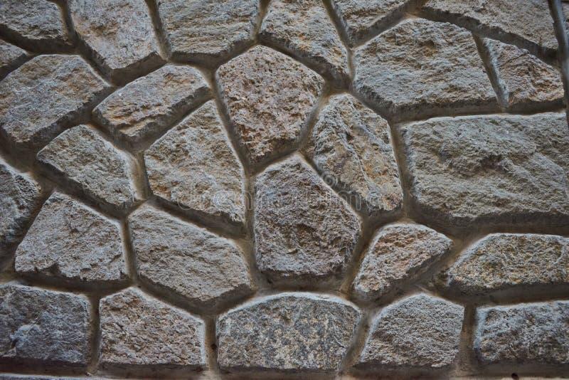 Vieille grosse texture brune et grise détaillée de fond de mur de pierres photos libres de droits
