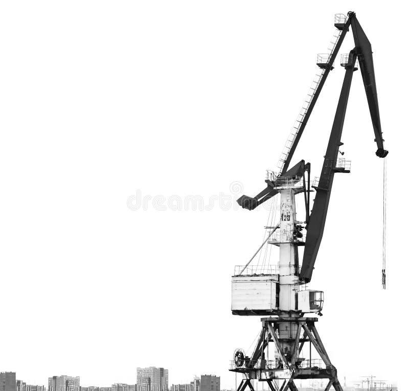 Vieille grue de port d'isolement sur le fond blanc Le contour des bâtiments et des maisons photos libres de droits