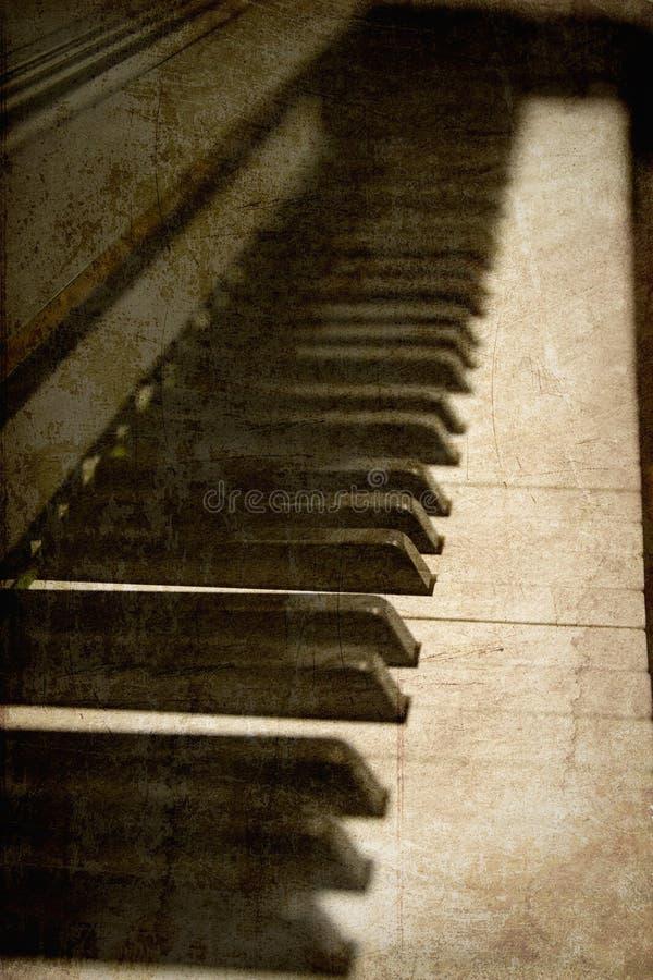 Vieille image des clés de piano photographie stock