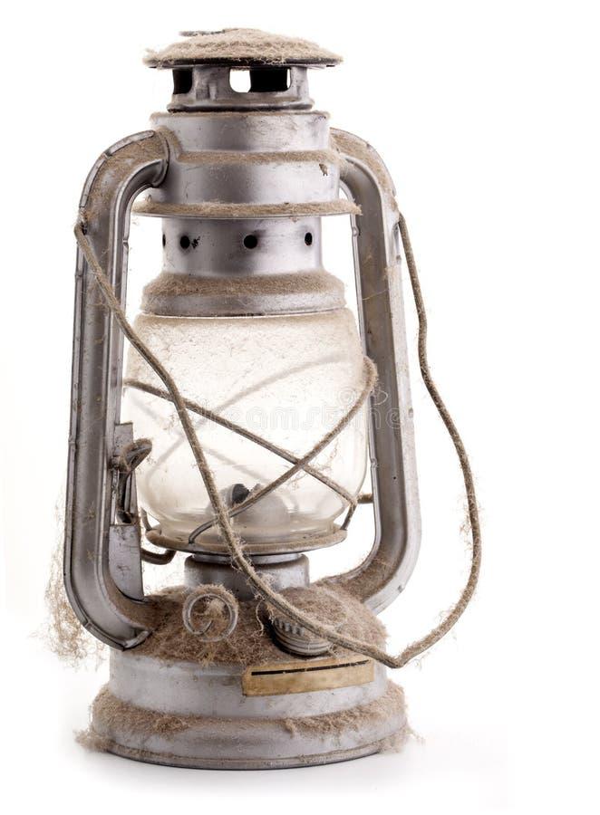 Vieille lampe à pétrole poussiéreuse photo libre de droits