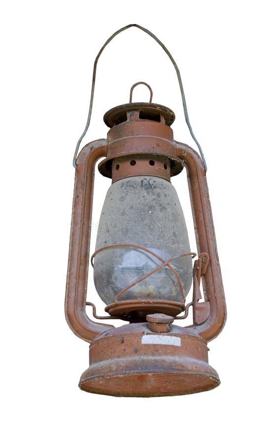 Vieille lampe à pétrole poussiéreuse d'isolement sur le blanc photos stock
