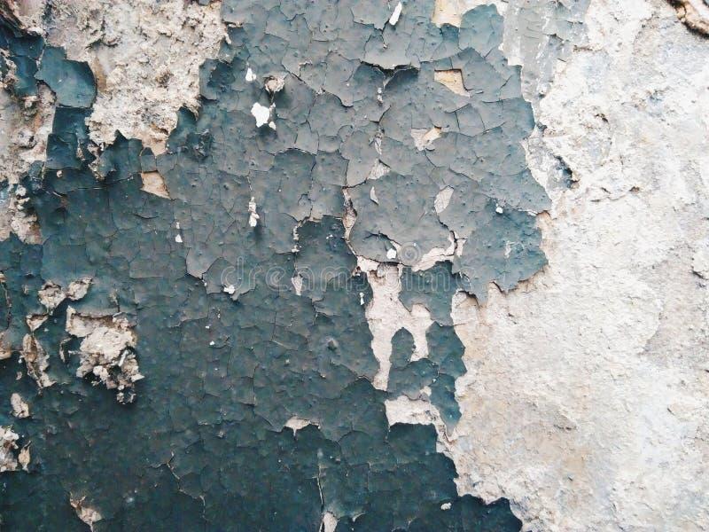 vieille peinture d'épluchage sur un mur, texture image stock
