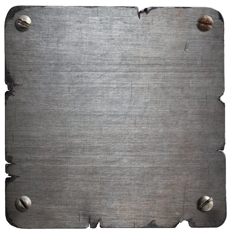 Vieille plaque de métal déchirée avec des boulons d'isolement photographie stock libre de droits
