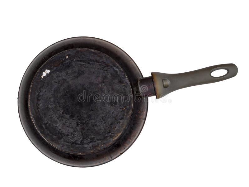 Vieille poêle encroûtée et brûlée, d'isolement sur le blanc underside image stock