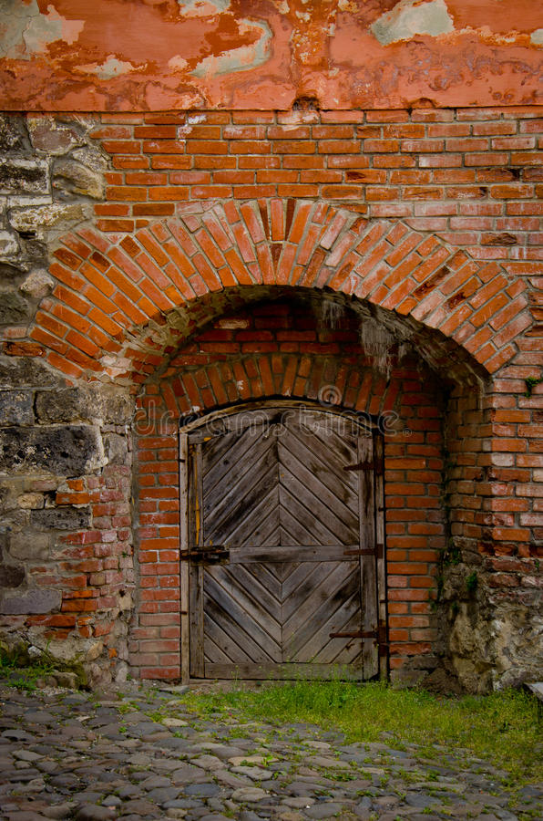 Vieille porte de forteresse photographie stock