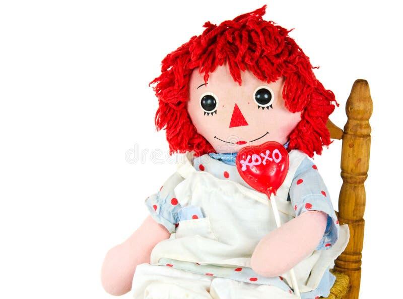 Vieille poupée de chiffon avec la lucette de coeur image stock