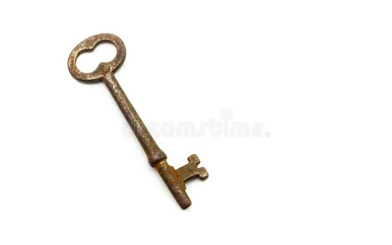 Vieille, rouillée clé antique sur le fond blanc images libres de droits