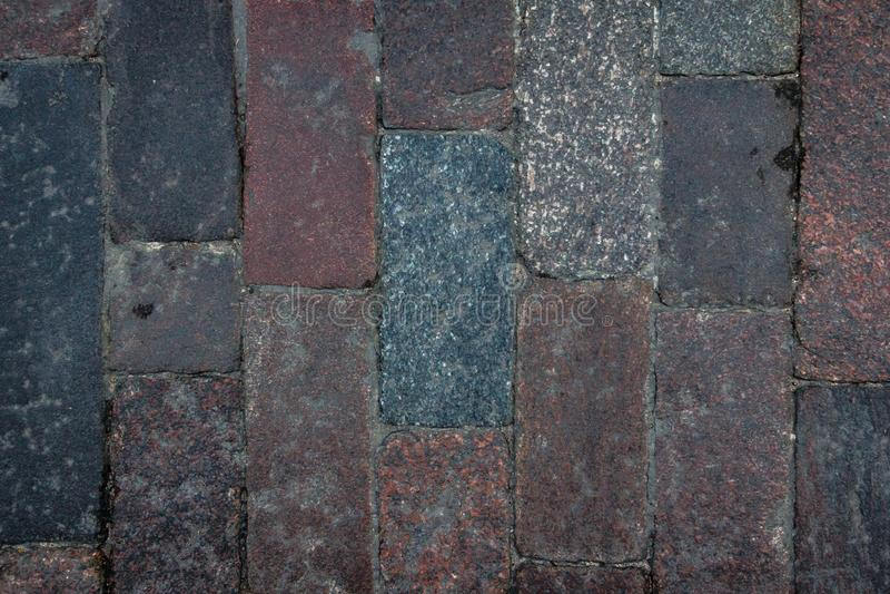 Vieille texture de tuile de pavé rond dans la vieille ville Fond de trottoir de ville Modèle en pierre de brique de granit de rés photographie stock