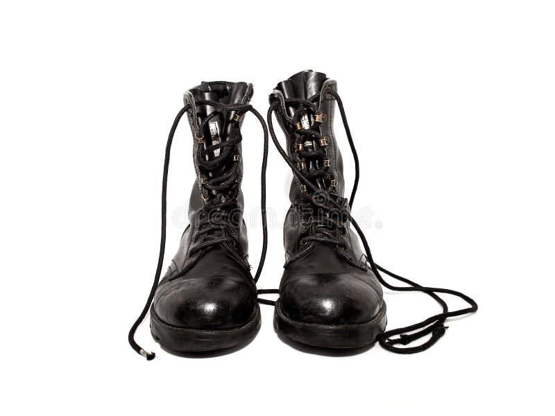 Vieilles bottes d'armée image stock