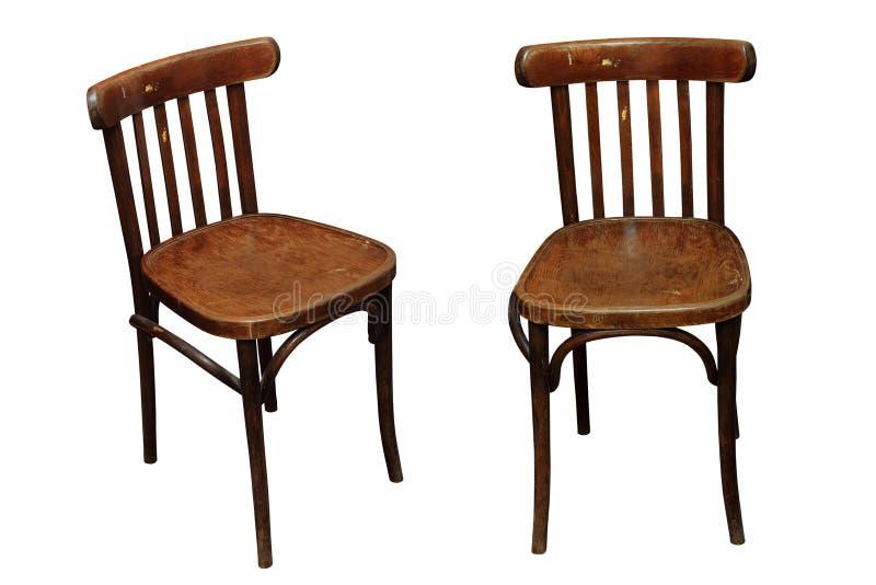 Vieilles chaises d'isolement photo stock
