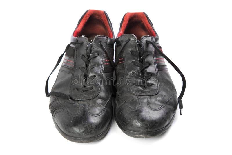 Vieilles chaussures avec des dentelles photos stock