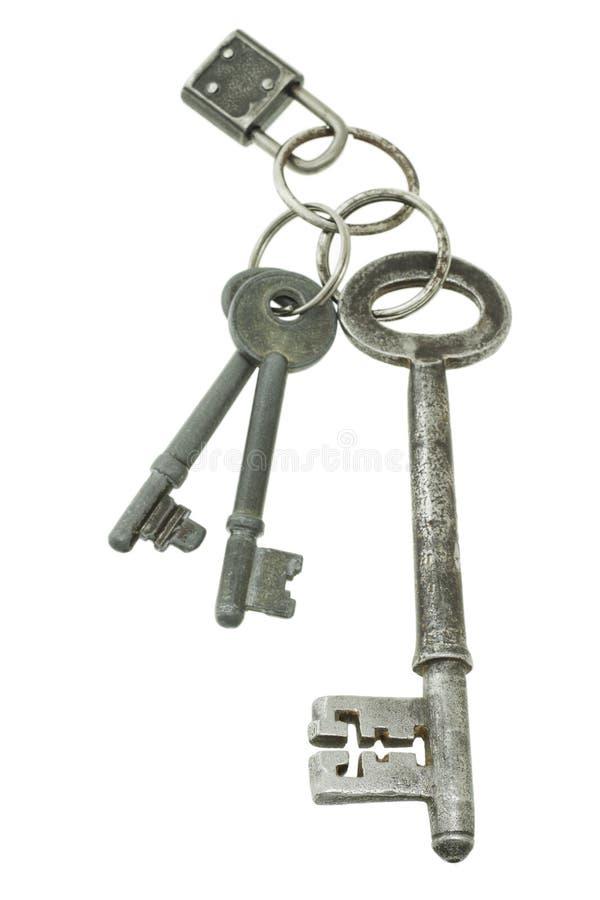 Vieilles clés avec le mini blocage de garniture image stock