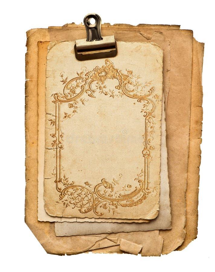 Vieilles feuilles de papier blanc avec l'ornement d'or images libres de droits