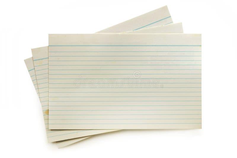 Vieilles fiches d'isolement sur le blanc avec l'ombre molle photos stock