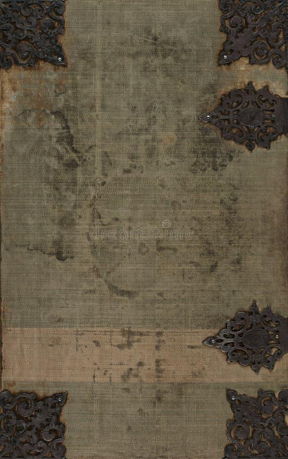 Vieja cubierta de libro de paño con adornos del metal imagenes de archivo