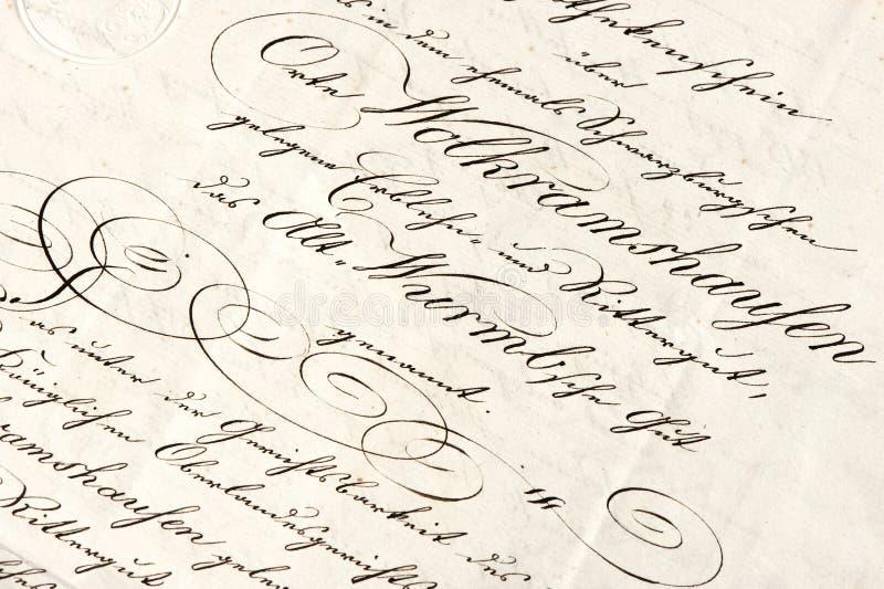 Vieja letra con el texto manuscrito caligráfico fotos de archivo