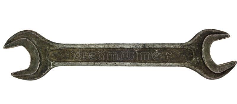 Vieja llave inglesa oxidada aislada en el fondo blanco fotografía de archivo