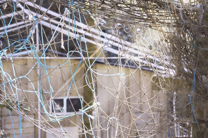 Vieja red enredada de la cuerda imagen fotos de archivo