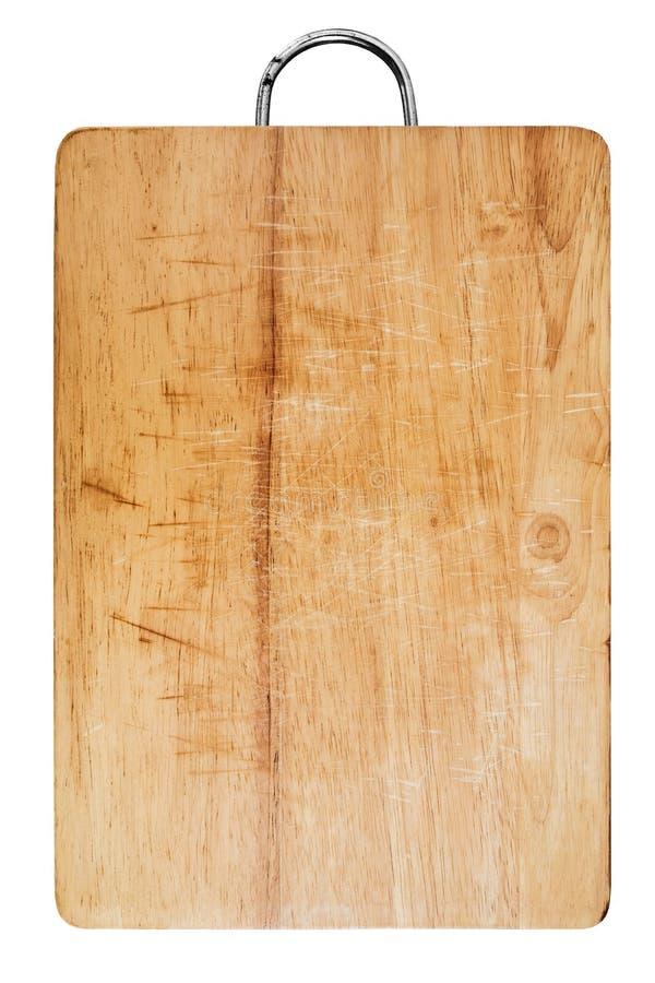 Vieja tabla de cortar de madera rasguñada, aislada en el fondo blanco fotografía de archivo libre de regalías