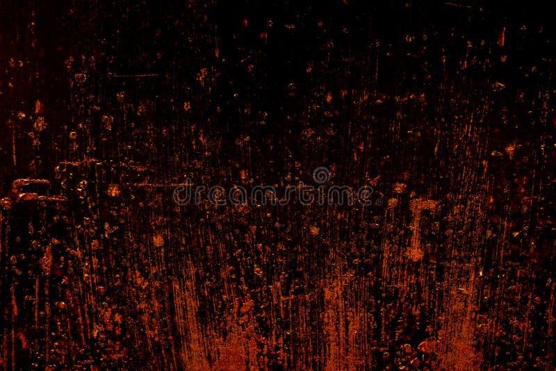 Vieja textura áspera oxidada asustadiza oscura de la superficie de metal/fondo de oro y de cobre para Halloween o el fondo de los fotografía de archivo