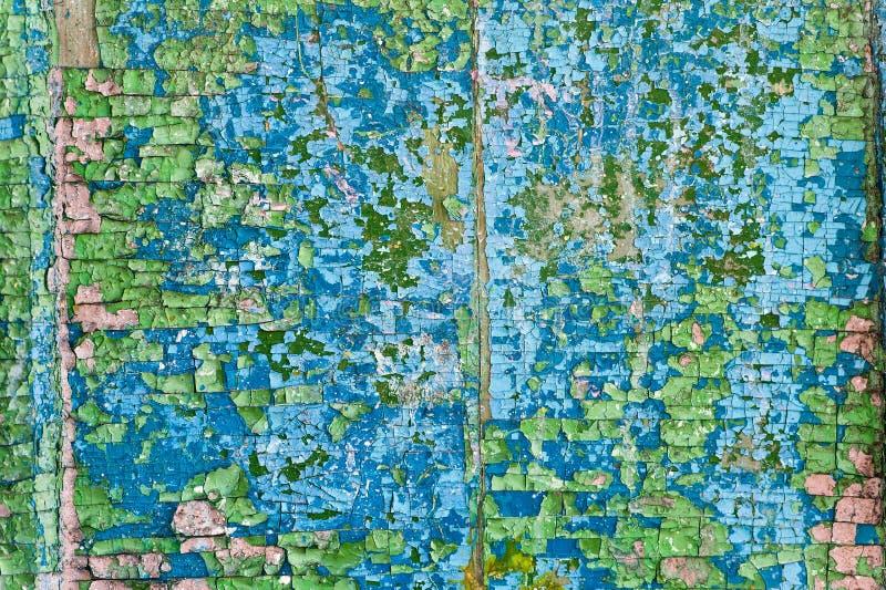 Vieja textura agrietada del vintage del grunge de la pintura en una pared de madera fotos de archivo