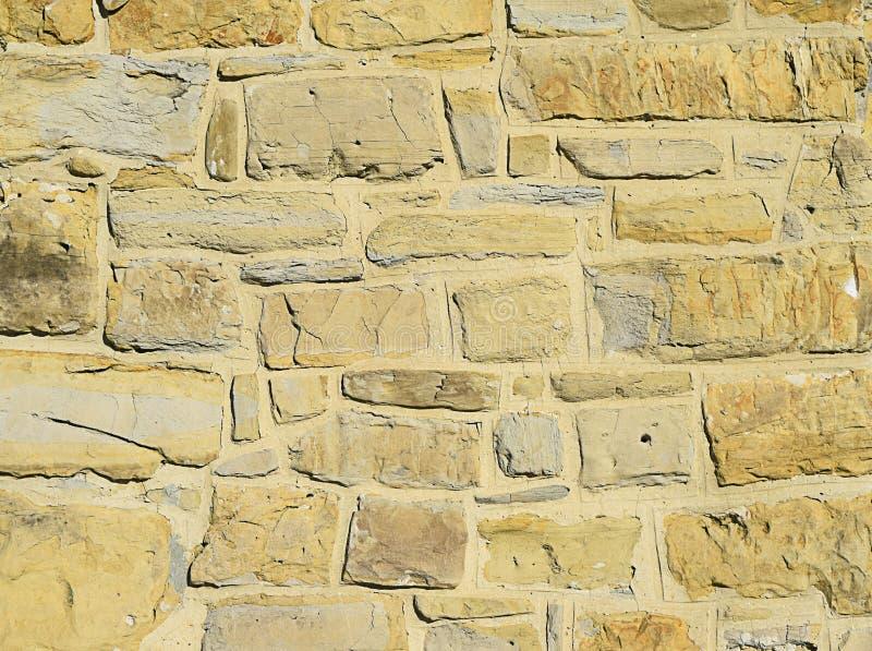 Vieja textura amarilla de la pared de piedra fotos de archivo libres de regalías