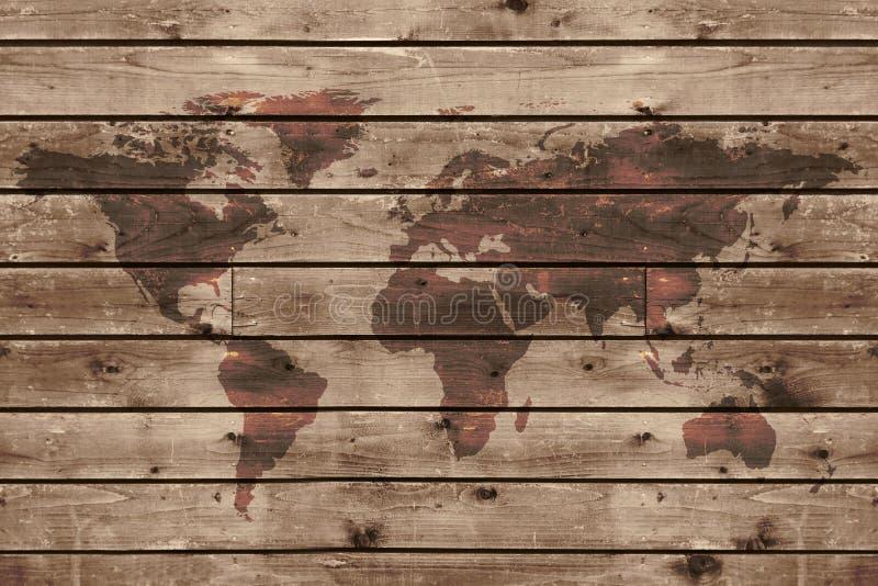 Vieja textura de madera con el mapa del mundo fotos de archivo libres de regalías