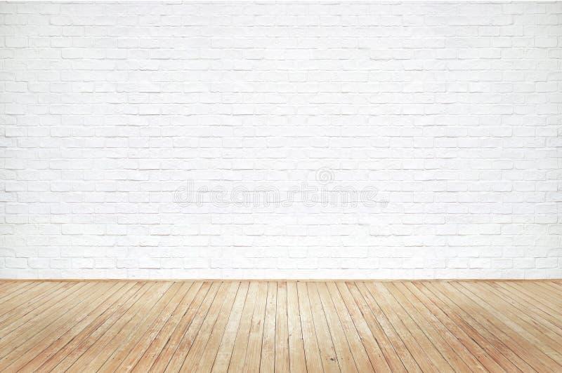 Vieja textura de madera marrón del piso del vintage y pared de ladrillo blanca foto de archivo libre de regalías