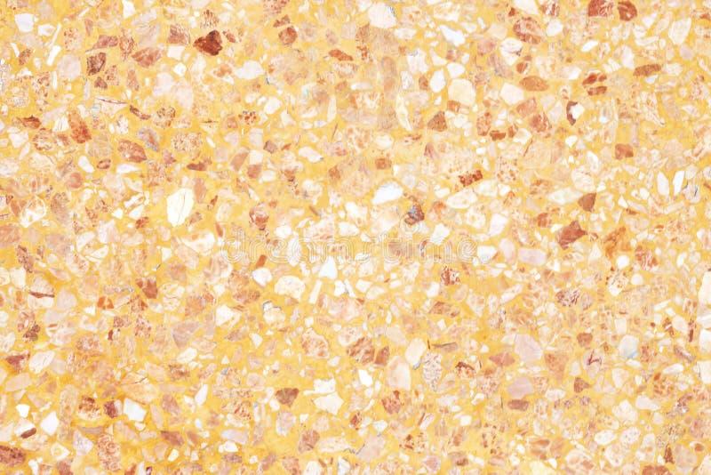 Vieja textura del piso anaranjado del terrazo o piedra pulida para el fondo imágenes de archivo libres de regalías