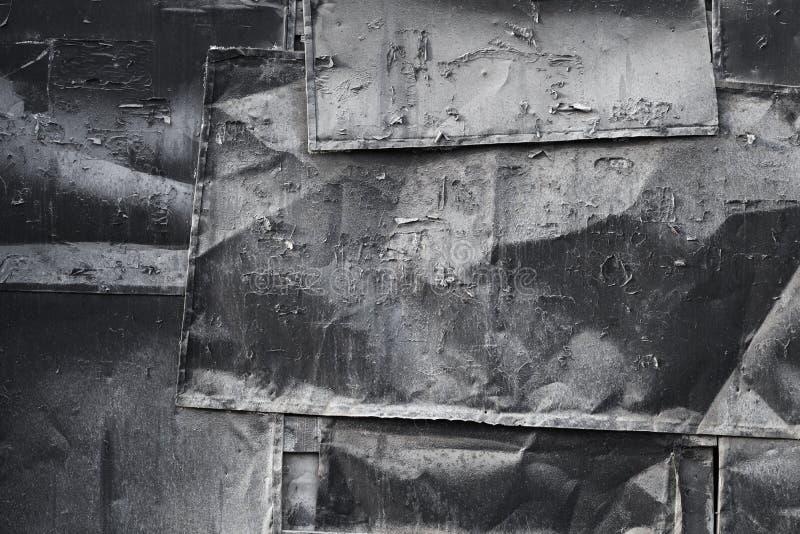 Vieja textura negra dañada de la pared del metal fotografía de archivo