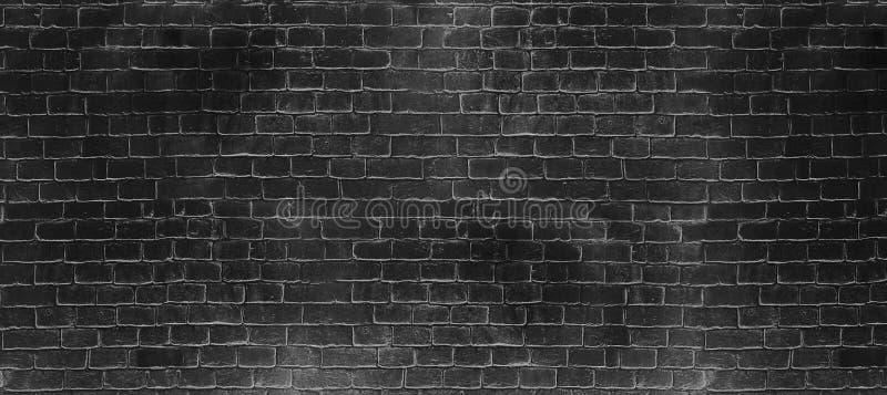 Vieja textura negra oscura de la pared de ladrillo del lavado del vintage Fondo panorámico para su texto o imagen imágenes de archivo libres de regalías