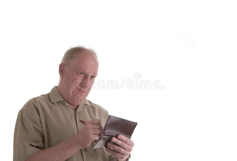 Vieja verificación de la escritura del individuo y el parecer trastornado foto de archivo libre de regalías