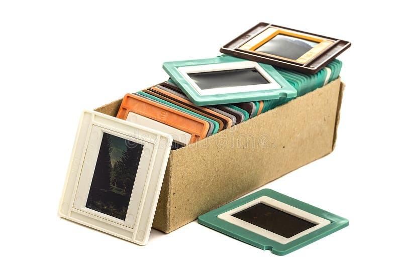 Viejas diapositivas en una caja de cartón imágenes de archivo libres de regalías