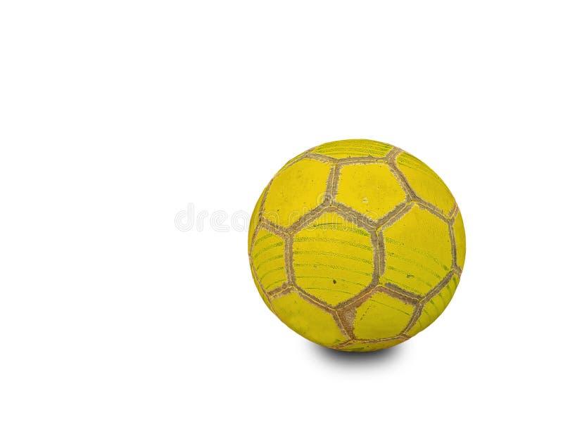 Viejo amarillo del fútbol de la bola llevado aislado en blanco fotografía de archivo libre de regalías